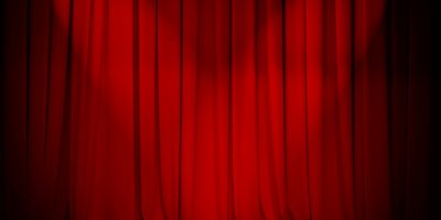 theatre red curtain with two lights cross
